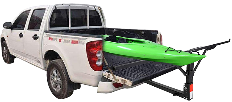 Truck with an extender and a kayak in the back