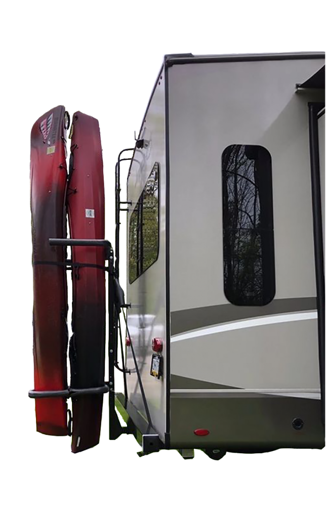An RV with two kayaks attached in the back