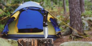 Camping knife with tent in background
