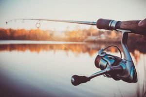 Spinning rod with river as background