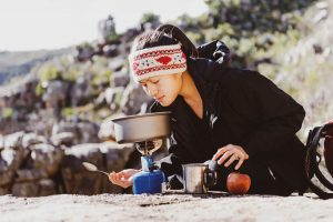 Backpacking woman cooking