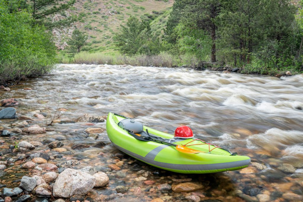 inflatable whitewater kayak on mountain river