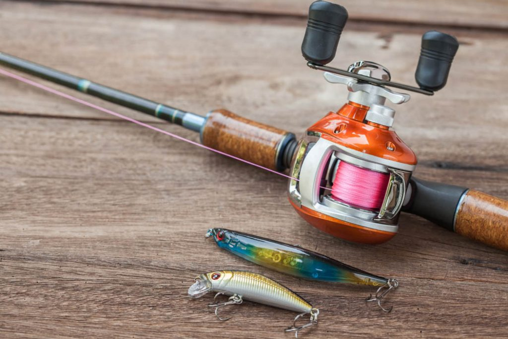 Baitcasting reel with lures and hooks