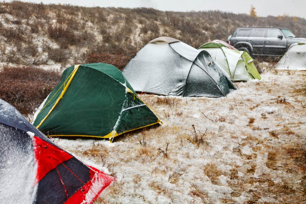 four tents covered with snow