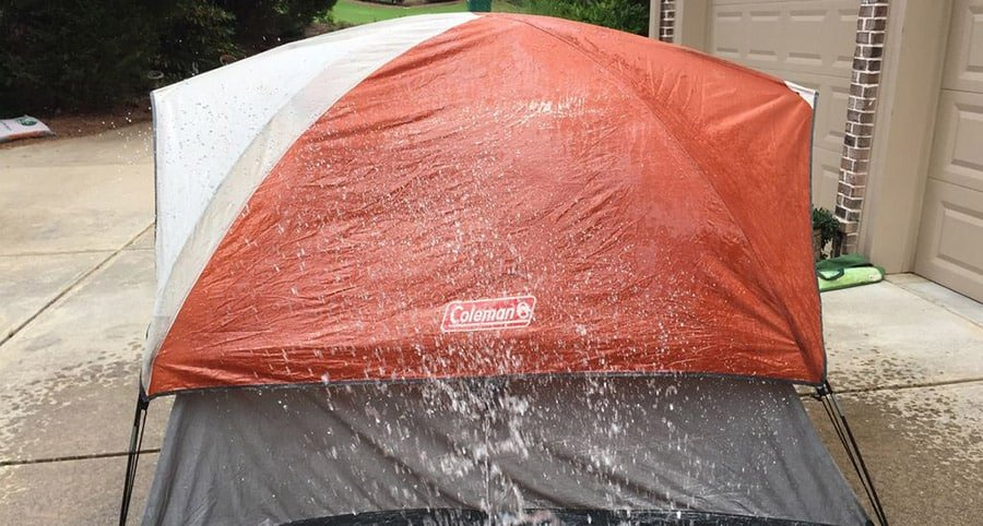 Cleaning a tent with water