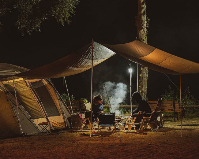 Tent overlay with 2 people having dinner