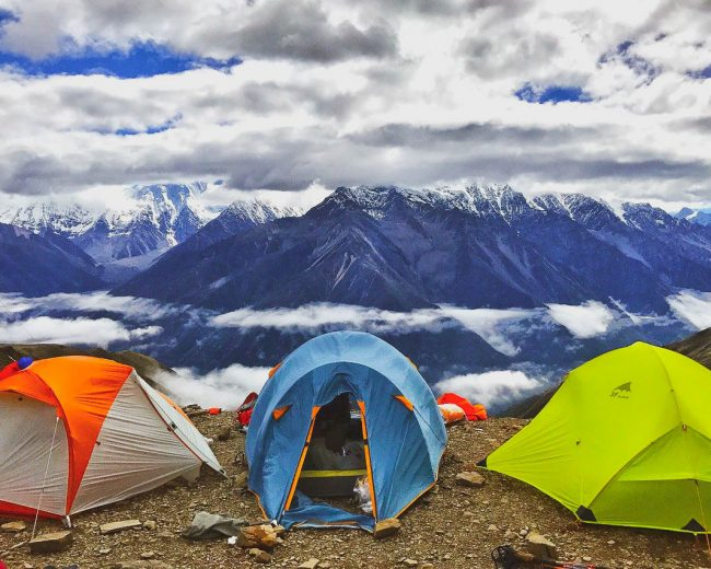 3 tents with view of mountain peaks