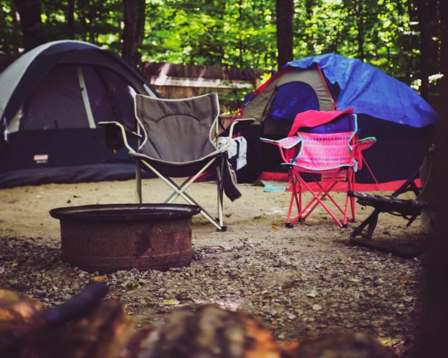 campsite with camping chairs and tents