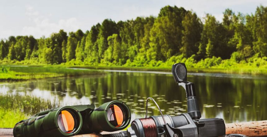 fishing tackle on a pontoon on the background of the lake in the woods