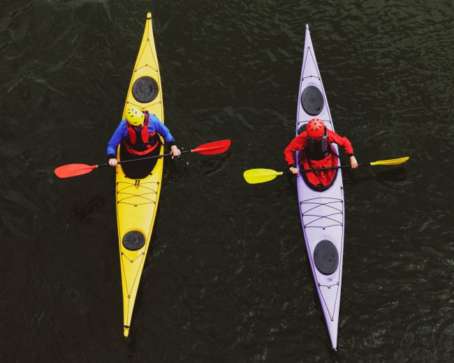 Two people on a touring kayak