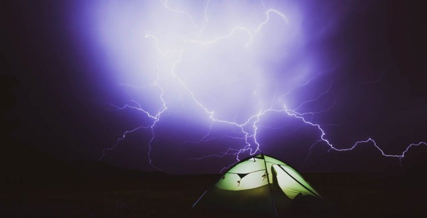 Pitched tent under lightning